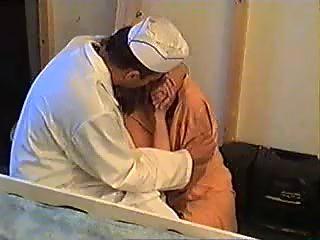 Doctor calms woman after rape