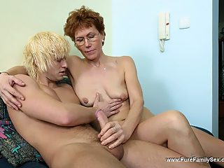 Blond boy oils his mamas jugs before switching on to her smooth fuck hole