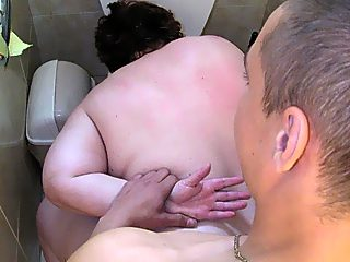 Horny boy peeps at a peeing milf and then violates her