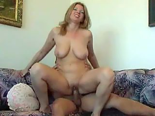 Mature lady with a big rack worth dying for grinds on her son's sturdy rod