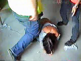 Abusers kick girl in torn clothes