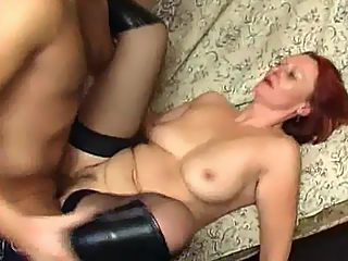 Muscled lover's red haired aunt bounces on his massive shlong like crazy