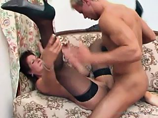 Yummy oldie gives her grandson a handjob before letting him test her pussy