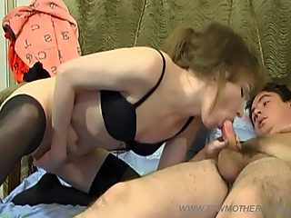 Juicy stockinged milf trades her dildo for her own sons stone hard cock