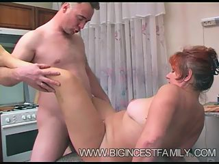 Wild kitchen sex between horny father and hungry granny