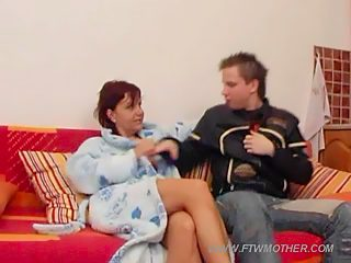 Yummy milf with long saggy jugs bounces on top of her son's strong love rod