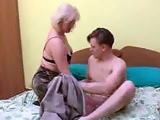 Mommy spreads her stockinged legs letting her son plug her old juicy twat